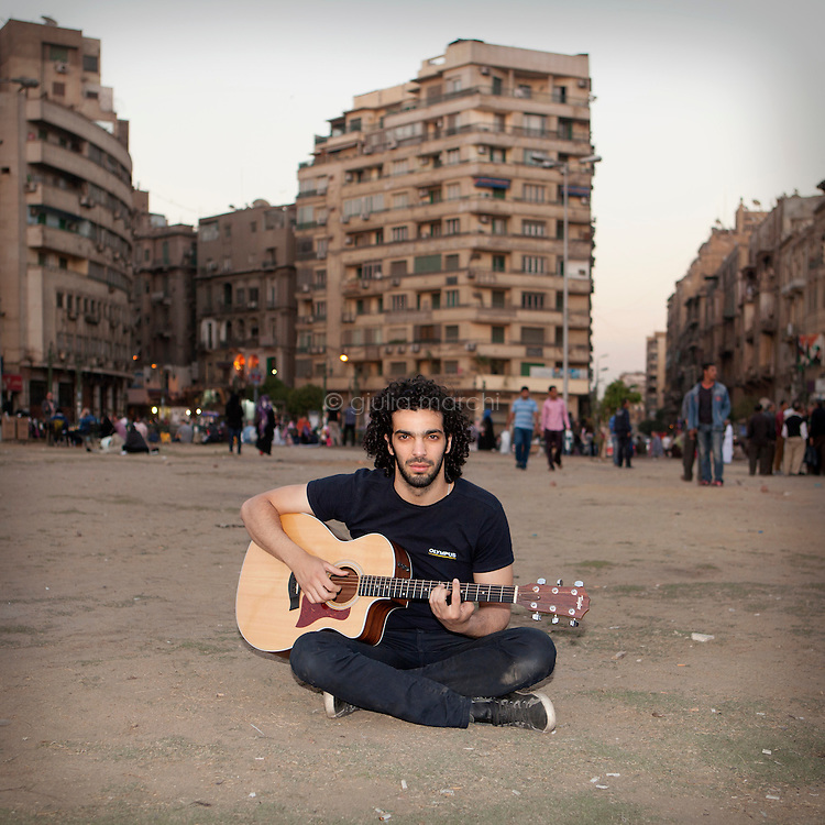 Egypt / Cairo / 5.4.2013 / Ramy Essam, Egyptian musician, poses with his guitar in Tahrir Square, in Downtown Cairo. © Giulia Marchi