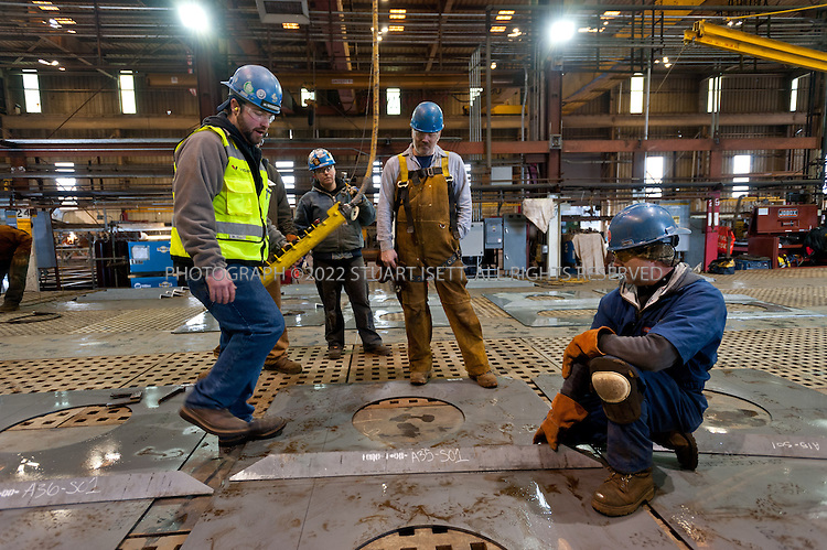 2/16/2012--Seattle, WA, USA<br /> <br /> Washington State&rsquo;s newest 144-car ferry is underway.<br /> <br /> The very first metal plates of the state&rsquo;s new ferry were welded in place on schedule today by workers at Vigor Industrial&rsquo;s Harbor Island shipyard in Seattle. Two years, 2917 tons of steel and more than half-a-million Washington worker-hours later, the new 144-car ferry will sail the waters of Puget Sound.<br /> <br /> Today&rsquo;s plates are the first pieces of the hull, which is being assembled by Vigor Industrial&rsquo;s US Fab subsidiary. The upper half of the vessel, above the car-deck level, will be crafted on Whidbey Island while end sections are manufactured in Tacoma. The large sections will later be assembled in Seattle, with final outfitting in Everett.<br /> <br /> This will be the ninth Washington State Ferry built at the Harbor Island shipyard. The keel section will be laid in place in the next six to eight weeks. The completed ferry will sail the waters of Puget Sound starting in 2014.<br /> <br /> The vessel, as yet unnamed, is designed to carry up to 144 cars and 1500 passengers at a time, up to a million or more passengers each year into the mid-21st century. The new ferry will have 50 percent more capacity than the Evergreen State class vessel it will replace as those older ferries reach the 60-year mark. Additional new ferries are envisioned to replace other parts of the fleet; nine of WSF&rsquo;s vessels are currently between 40 and 65 years old.<br /> <br /> Photograph by Stuart Isett/Vigor