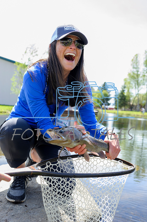 Holly Kuhlmann shows off her catch during the Casting for Recovery fishing clinic at Bently Ranch in Gardnerville, Nev. May 4, 2018.<br /> Photo by Candice Vivien/Nevada Momentum