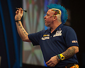 01.01.2014.  London, England.  William Hill PDC World Darts Championship.  Quarter Final Round.  Peter Wright (5) [SCO] in action during his game with Gary Anderson (4) [SCO]. Gary Anderson won the match 5-1