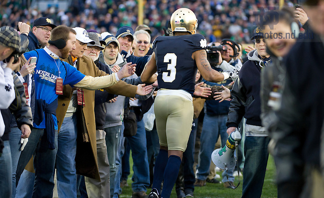November 19, 2011; Notre Dame Fighting Irish wide receiver Michael Floyd is greeted by fans as he runs onto the field before the game against Boston College Eagles. Photo by Barbara Johnston/University of Notre Dame.