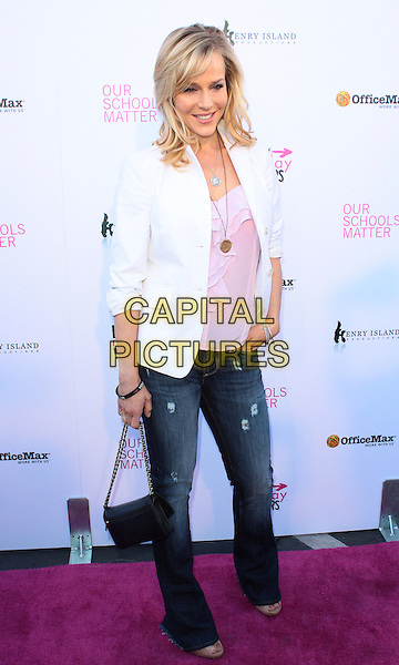 "JULIE BENZ.The Every Monday Matters Foundation presents ""1st Annual Party with a Purpose"" to launch the Our Schools Matter  held at  Smashbox Studios, West Hollywood, California, USA..May 3rd, 2010.full length jeans denim white blazer jacket pink top black bag purse .CAP/ADM/TC.©T. Conrad/AdMedia/Capital Pictures."