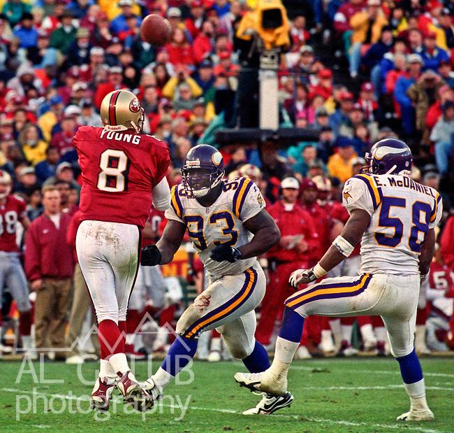 San Francisco 49ers vs. Minnesota Vikings at Candlestick Park Saturday, January 3, 1998.  49ers beat Vikings  38-22.  Minnesota Vikings defensive tackle John  (93) rushes San Francisco 49ers quarterback Steve Young (8).