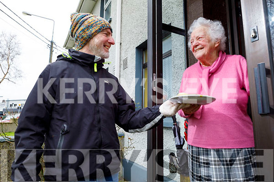 95 years old Kathleen O'Shea from St Johns Park receiving Meals on Wheels from Frank Ryan.