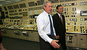 Lusby, MD - June 22, 2005 -- United States President George W. Bush tours the control room of the Cavert Cliffs Nuclear Power Plant in Lusby, MD on June 22, 2005.  On the right  is Mike Wallace, Chief Executive Officer (CEO) Constellation Energy.<br /> Credit: Dennis Brack - Pool via CNP