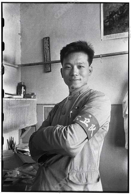 Self-portrait, Li in his office at the Heilongjiang Daily dons a Red Guard armband that he borrowed from the newspaper's printing shop (photographed with a self-timer). 6 July 1966