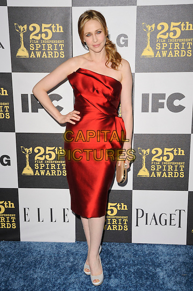 VERA FARMIGA.The 25th Annual Film Independent Spirit Awards at the LA Live Event Deck in Los Angeles, California, USA..March 5th, 2010  .full length red strapless silk satin dress hand on hip.CAP/ROT.©Lee Roth/Capital Pictures
