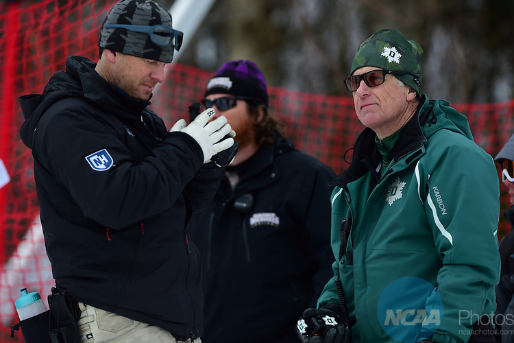 FRANCONIA, NH - MARCH 10:   UNH coach Brian Blank and Dartmouth coach Peter Dodge check their athletes from coaches knoll during the Men's Slalom event at the Division I Men's and Women's Skiing Championships held at Cannon Mountain on March 10, 2017 in Franconia, New Hampshire. (Photo by Gil Talbot/NCAA Photos via Getty Images)