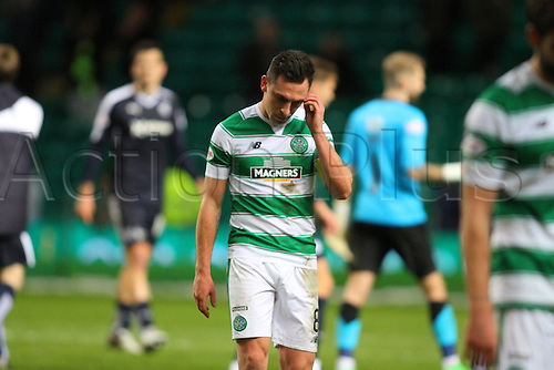 02.03.2016. Celtic Park, Glasgow, Scotland. Scottish Premier League. Celtic versus Dundee. Scott Brown leaves the park dejected after dropping 2 points in the 0-0 draw