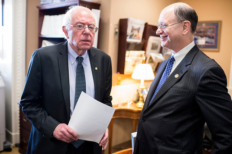 "UNITED STATES - MAY 6: Sen. Bernie Sanders, I-Vt., left, and Rep. Brad Sherman, D-Calif., talk in the Senate Radio/TV Gallery office before their news conference to unveil legislation to ""break up the nation's biggest banks"" on Wednesday, May 6, 2015. (Photo By Bill Clark/CQ Roll Call)"