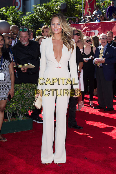 LOS ANGELES, CA - JULY 16: Christine Teigen at the 2014 ESPYs at Nokia Theatre L.A. Live in Los Angeles, California on July 16th, 2014.   <br /> CAP/MPI/mpi99<br /> &copy;mpi99/MediaPunch/Capital Pictures