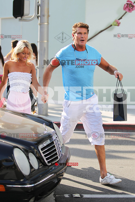 A special gift for a very special person? David Hasselhoff took his girlfriend Hayley Roberts out on a shopping spree at Harry Winston in Beverly Hills today. The happy couple also posed gladly with fans and enjoyed the attention. If they took their relationship to another level with their stop at on of the best jewelers in Beverly Hills? Los Angeles, California on 4.6.2012.Credit: Vida/face to face / Mediapunchinc ***NO PRINT - ONLINE AND NETWORK ONLY****
