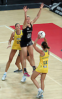 19.09.2013 Silver Ferns Casey Kopua and Australian Diamonds Natalie Medhurst in action during the Silver Ferns V Australian Diamonds New World Netball Series played at Vector Arena in Auckland. Mandatory Photo Credit ©Michael Bradley.