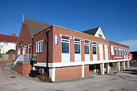 Derelict and empty Clowne Miners Welfare building in the former Derbyshire coal mining community.