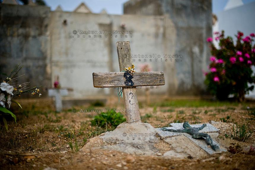 Lampedusa, 21 Aprile, 2011. Tombe senza nome di immigrati morti in mare, nel cimitero di Lampedusa.<br /> Tombs of immigrants without name at Lampedusa cemetery