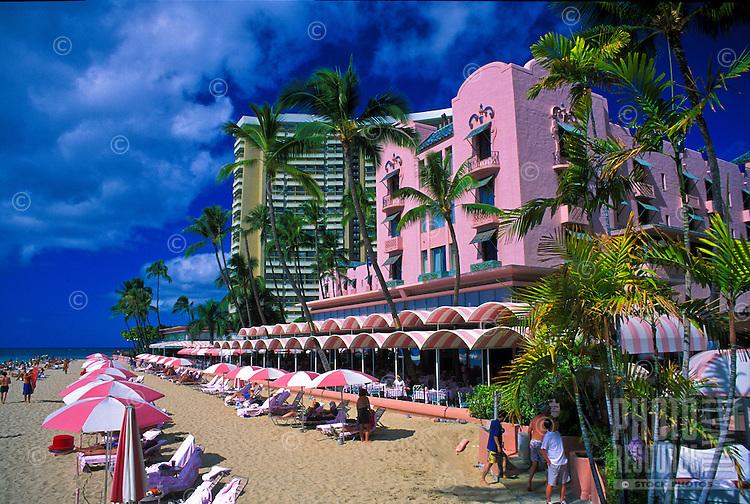 The Royal Hawaiian Hotel and vacationers on Waikiki Beach.