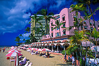 The Royal Hawaiian Hotel and vacationers on Waikiki Beach.
