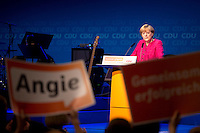 Bundeskanzlerin Angela Merkel (CDU) spricht am Samstag (21.09.13) in Berlin bei ihrem Wahlkampfabschluss im Tempodrom.<br /> <br /> The top-candidate of the Christ Democratic Party (CDU) and Chancellor of Germany Angela Merkel attend a town-hall election rally event in Berlin, September 21, 2013. <br /> <br /> Foto: Axel Schmidt/CommonLens