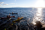 From left, Julio Ayala, Chuck Freedman, and Harry King kayak on Lake Tahoe near Kings Beach, Calif., January 19, 2011.