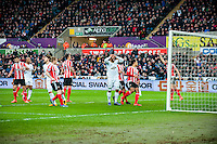 Ashley Williams of Swansea City reacts after missing a header during the Barclays Premier League match between Swansea City and Southampton  played at the Liberty Stadium, Swansea  on February 13th 2016