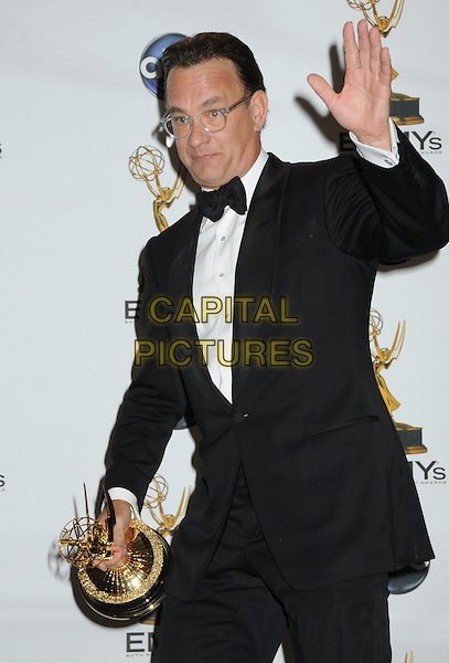 TOM HANKS .60th Annual Primetime Emmy Awards held at the Nokia Theatre, Los Angeles, California, USA..September 21st, 2008.pressroom press room half length black tuxedo jacket award trophy glasses hand palm waving .CAP/ADM/BP.©Byron Purvis/AdMedia/Capital Pictures.
