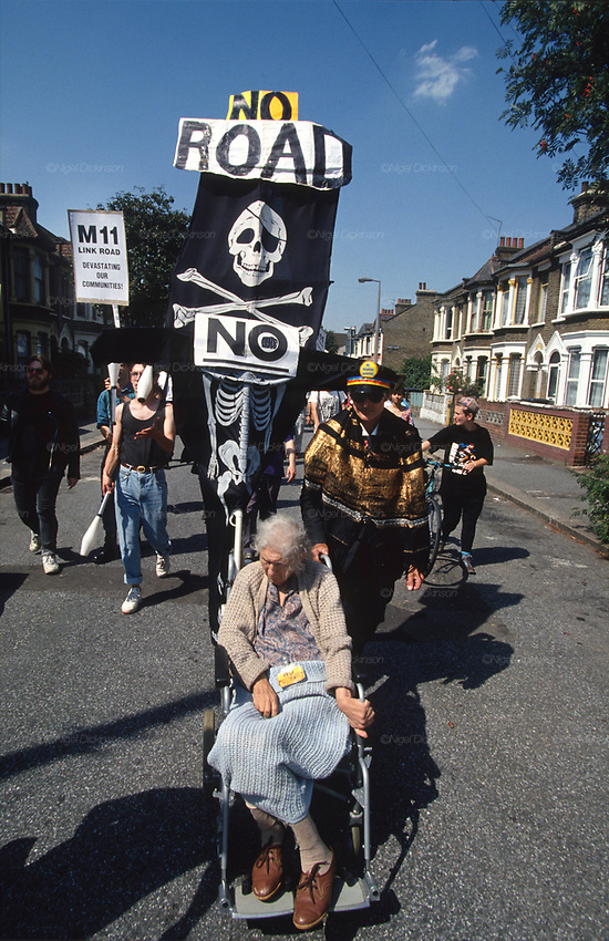 Demonstration against MII. Claremont Road, Leytonstone, London. Claremont Road, ran immediately next to the Central line, and was completely occupied by protesters. The road became a vibrant squatter community full of site specific art installations. 92-year-old Dolly Watson was an original resident refused the D.O.T's offer to move. She became friends with the road protesters, who named the watchtower, built from scaffold poles, after her.<br />