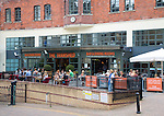 People sitting outside the Tramshed bar and restaurant, Walcot Street, Bath, England