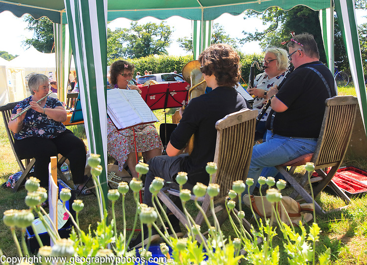 Musicians performing at summer village event Blaxhall church, Suffolk, England, UK