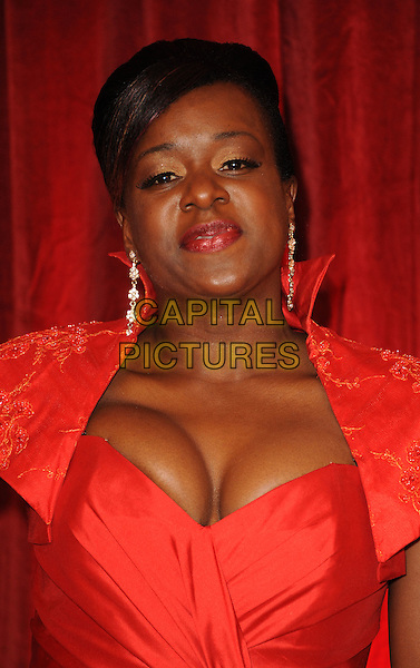 Tameka Empson.British Soap Awards held at the ITV Studios, South Bank, London, England..April 28th 2012.headshot portrait red cleavage lipstick dangling earrings .CAP/WIZ.© Wizard/Capital Pictures.