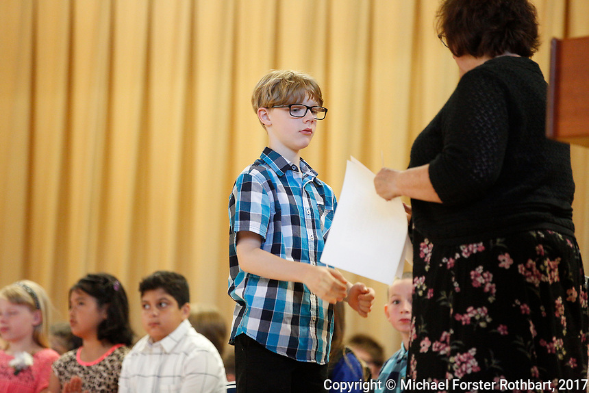 The Oneonta Greater Plains elementary school fifth grade awards ceremony, on June 21, 2017.<br /> &copy; Michael Forster Rothbart Photography<br /> www.mfrphoto.org &bull; 607-267-4893<br /> 34 Spruce St, Oneonta, NY 13820<br /> 86 Three Mile Pond Rd, Vassalboro, ME 04989<br /> info@mfrphoto.org<br /> Photo by: Michael Forster Rothbart<br /> Date:  6/21/2017<br /> File#:  Canon &mdash; Canon EOS 5D Mark III digital camera frame C19155