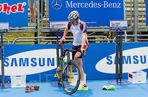 24 JUN 2012 - KITZBUEHEL, AUT - Alistair Brownlee (GBR) of Great Britain finds himself in the unusual position of not attracting television interest as he prepares in transition for the elite men's 2012 World Triathlon Series round at Schwarzsee in Kitzbuehel, Austria away from the top spot having not raced this season .(PHOTO (C) 2012 NIGEL FARROW)