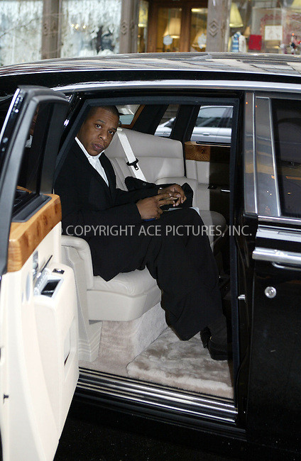 Rapper Jay Z exits Cipriani's Downtown and leaves in an armoured Roll Royce. New York City, December 10 2003. Please byline: NY Photo Press.   ..*PAY-PER-USE*      ....NY Photo Press:  ..phone (646) 267-6913;   ..e-mail: info@nyphotopress.com