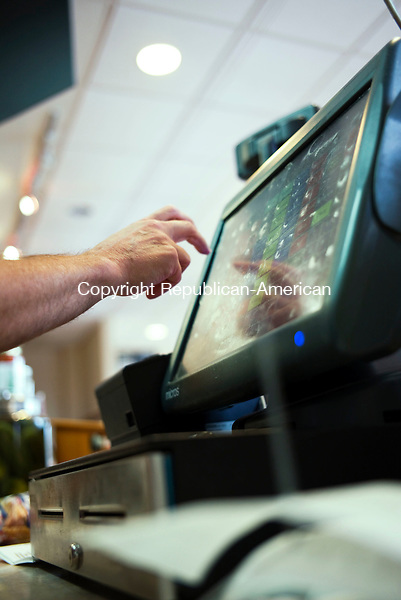 Waterbury, CT- 30 September 2015-093015CM04- Stewart Rosen, owner at the Nardelli's on Watertown Ave. rings out a customer in Waterbury on Wednesday.  The restaurant will be acquiring a new Point of Service (POS) register.      Christopher Massa Republican-American