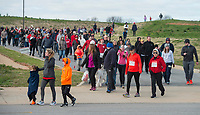 NWA Democrat-Gazette/BEN GOFF @NWABENGOFF<br /> Participants take part in the walk Saturday, April 14, 2018, during the American Heart Association's annual Northwest Arkansas Heart Walk at the Walmart AMP in Rogers.