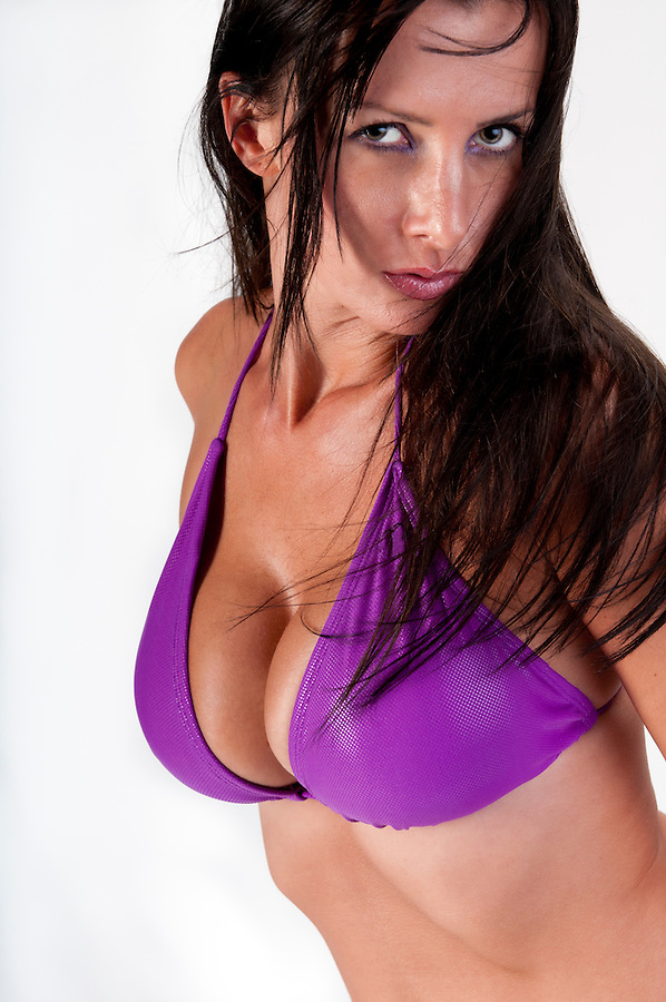 Sensual brunette looking very sensual with swimsuit