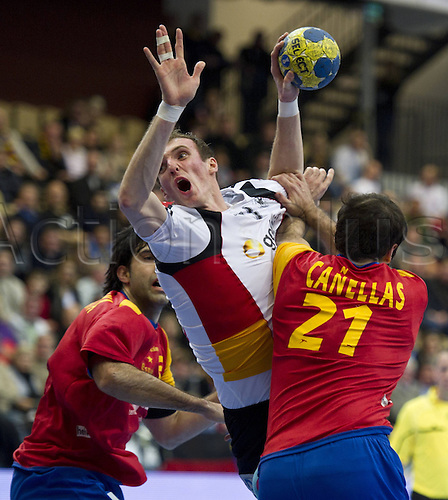 17 01 2011 Holger Glandorf ger centre against The Spaniards Jorge Maqueda Pena left and Joan Canellas Reixach right both ESP  Group A Spain Germany in Kristianstad at 17 01 2011 Handball 22 Handball World Cup for men  in Sweden 2011