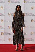 London, UK. 8 May 2016. Actress Gemma Chan. Red carpet  celebrity arrivals for the House Of Fraser British Academy Television Awards at the Royal Festival Hall.