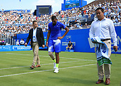 June 19th 2017, Queens Club, West Kensington, London; Aegon Tennis Championships, Day 1; Australia is escorted back to his seat after being injured attempting to play a forehand versus Donald Young of USA