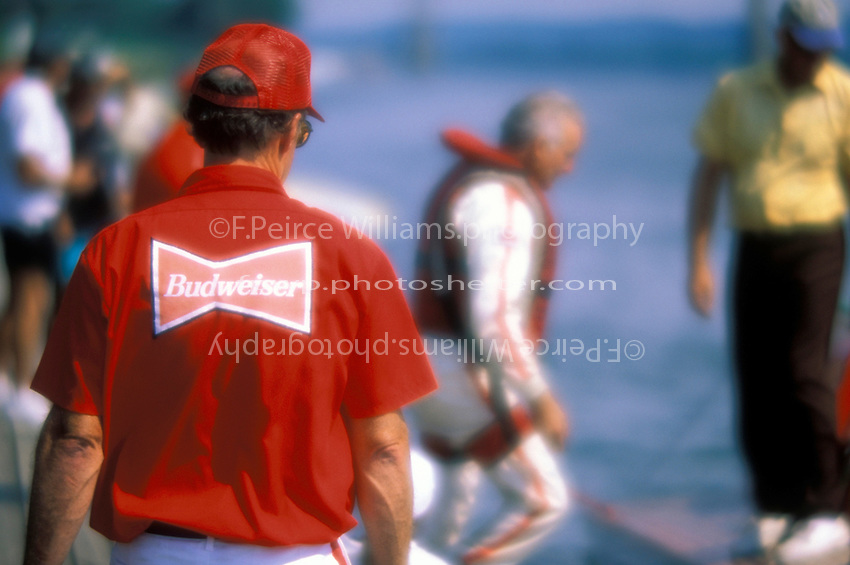 """""""Miss Budweiser crewman"""" Bill Fisk follows driver Ken Muskatel onto the dock...On the set of the movie """"MADISON"""". Madison, IN USA 6 September, 1999."""