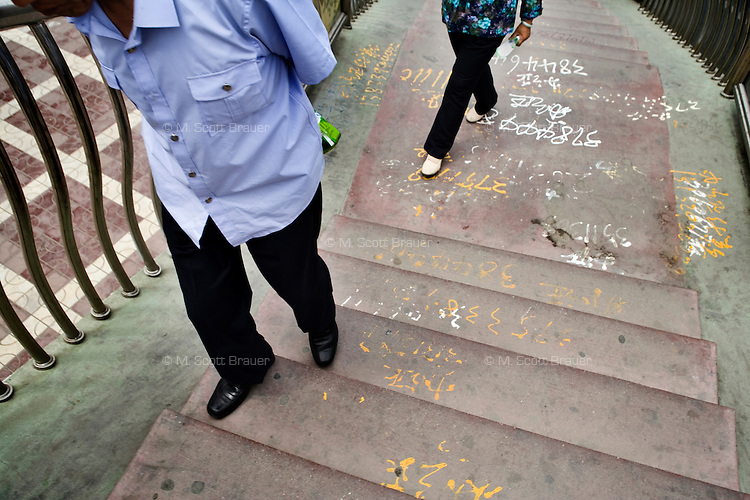Laborers numbers are painted on the ground in Lanzhou, Gansu, China.