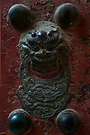 An ancient iron door knocker in the Forbidden City.