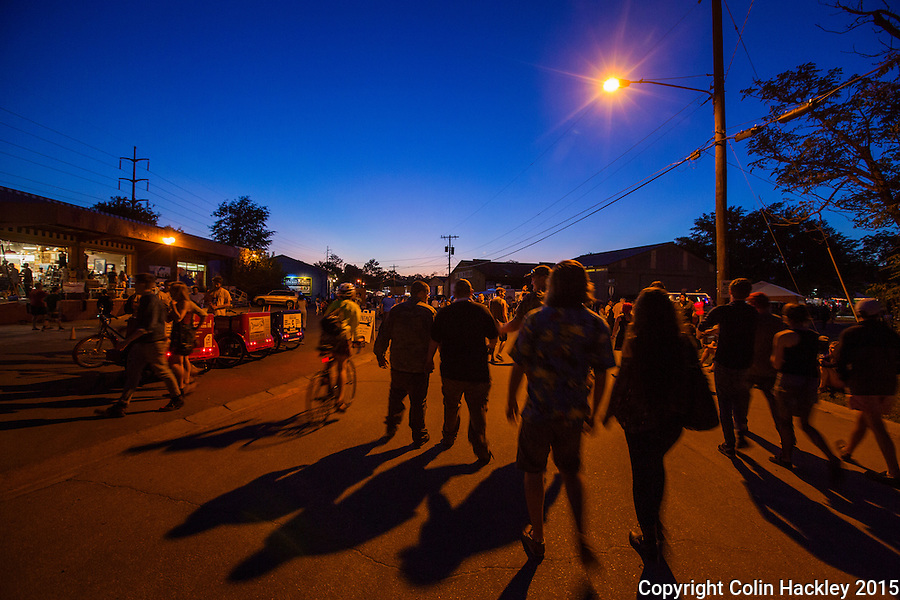 First Friday visitors walk into Tallahassee's Railroad Square at dusk to sample and eclectic collection of music, food and art.<br /> <br /> COLIN HACKLEY PHOTO