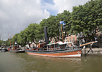 Historic boats and buildings in Wolwevershaven, Dordrecht, Netherlands