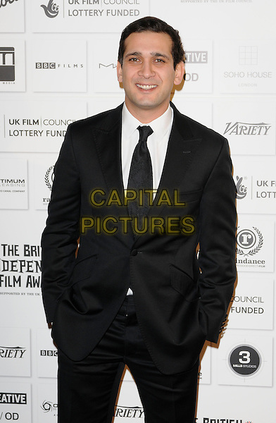 JIMI MISTRY .Attending The British Independent Film Awards,The Brewery, London, England, UK, December 6th 2009. .half length black suit  tie hands in pockets .CAP/CAN.©Can Nguyen/Capital Pictures.