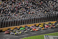 Oct. 17, 2009; Concord, NC, USA; NASCAR Sprint Cup Series driver Jimmie Johnson (48) races alongside Kasey Kahne (9) on a restart during the NASCAR Banking 500 at Lowes Motor Speedway. Mandatory Credit: Mark J. Rebilas-