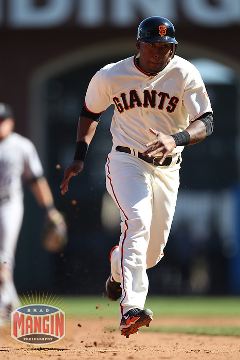 SAN FRANCISCO - SEPTEMBER 20:  Francisco Peguero of the San Francisco Giants runs the bases during the game against the Colorado Rockies at AT&T Park on September 20, 2012 in San Francisco, California. (Photo by Brad Mangin)