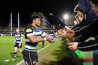 Amanaki Mafi of Bath Rugby hands his boots and a signed ball to supporters after the match. Aviva Premiership match, between Bath Rugby and Saracens on April 1, 2016 at the Recreation Ground in Bath, England. Photo by: Patrick Khachfe / Onside Images