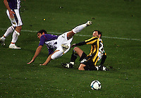 Phoenix captain Andrew Durante tackles Andrija Jukic during the A-League football match between Wellington Phoenix and Perth Glory at Westpac Stadium, Wellington, New Zealand on Sunday, 16 August 2009. Photo: Dave Lintott / lintottphoto.co.nz