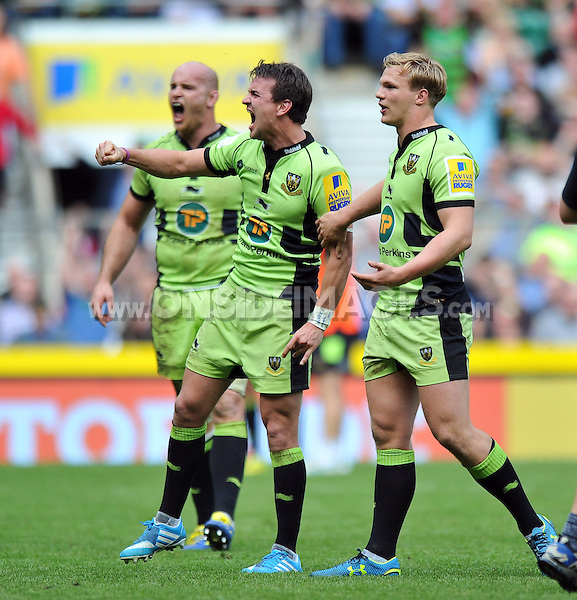 Lee Dickson celebrates as a replay of Alex Waller's last minute try is shown on the big screen. Aviva Premiership Final, between Saracens and Northampton Saints on May 31, 2014 at Twickenham Stadium in London, England. Photo by: Patrick Khachfe / JMP