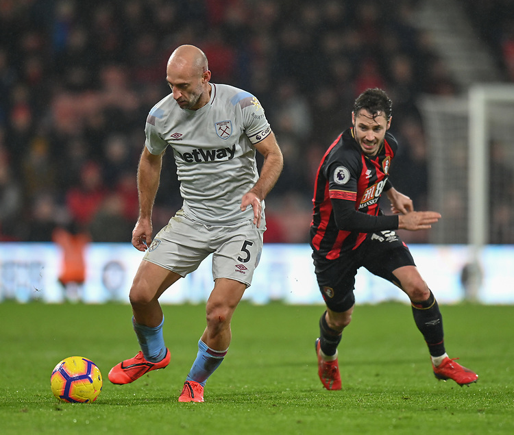 West Ham United's Pablo Zabaleta (left) under pressure from Bournemouth's Adam Smith (right) <br /> <br /> Photographer David Horton/CameraSport<br /> <br /> The Premier League - Bournemouth v West Ham United - Saturday 19 January 2019 - Vitality Stadium - Bournemouth<br /> <br /> World Copyright © 2019 CameraSport. All rights reserved. 43 Linden Ave. Countesthorpe. Leicester. England. LE8 5PG - Tel: +44 (0) 116 277 4147 - admin@camerasport.com - www.camerasport.com